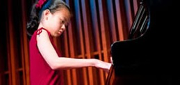 Image of girl playing the piano